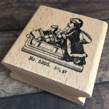 Rubber stamp santa on sledge